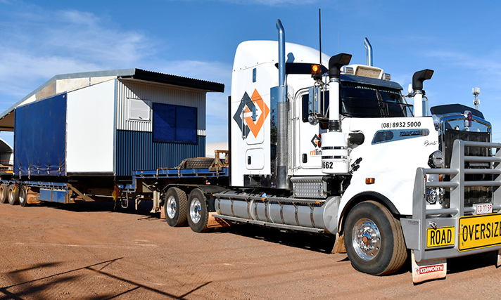 Prefabricated homes on truck ready to leave NT Link yard.